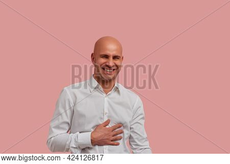 Enough To Make A Cat Laugh. Positive And Joyful Bald Guy In White Shirt Bursting Into Laughing Holdi