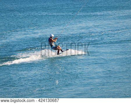 Riding A Wakeboard At Sea On A Reversible Winch. Caspian Sea. Kazakhstan. Aktau City. 08 September 2