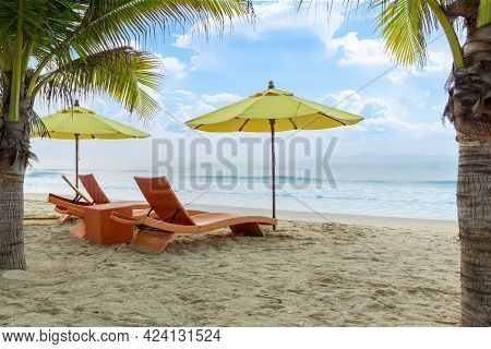 Beach Chair Under The Big Umbrella And Was On The Beach. Beautiful Beach. Chairs On The Sandy Beach