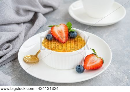Creme Brulee. Traditional French Vanilla Cream Dessert With Caramelised Sugar And Fresh Berries On T