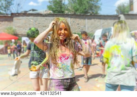 The Pretty Young Womans In The Color Fest, Colored Face Of The Young Womans, Color Festival In India