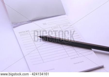 Blank Notes Of Purchase And Ballpoint Pens. The Concept Of Counterfeiting In The Purchase Of An Item