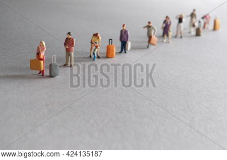 Miniature People, Vacation Travellers In A Queue