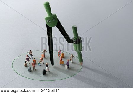 Compass With Green Pencil Circle Around Miniature Travellers Representing Restriction Free Zones
