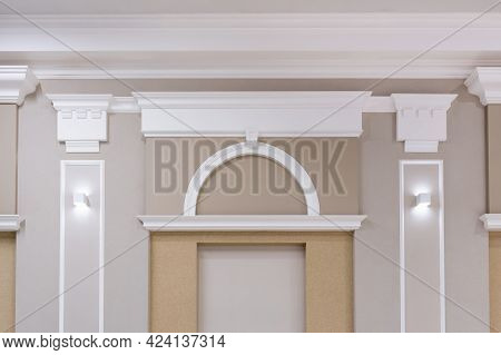 Detail Of Corner Ceiling With Intricate Crown Molding On Column With Spot Light