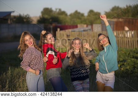 Girls In The Style Of The Nineties. Country Girls Posing For The Camera.