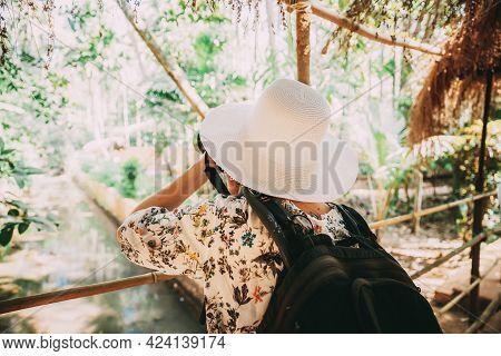 Goa, India. Young Backpacker Tourist Photographed Nature In Sahakar Plantation