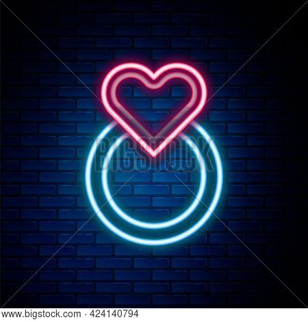 Glowing Neon Line Wedding Rings Icon Isolated On Brick Wall Background. Bride And Groom Jewelry Sign