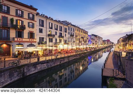 Naviglio Grande Canal At The Evening.when The Lights Of The City And The Bars Come On And The Nightl