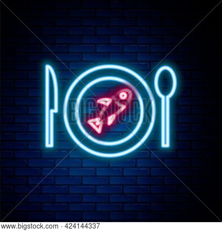 Glowing Neon Line Served Fish On A Plate Icon Isolated On Brick Wall Background. Colorful Outline Co