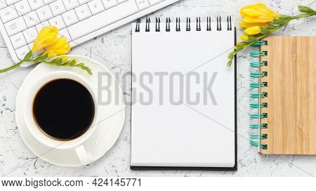 Office Workplace Background With Notepad For Writing, White Keyboard, Cup Of Fresh Coffee And Yellow