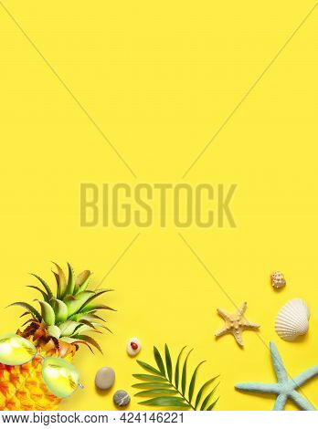 Summer Background. Palm Leaf, Pineapple With Sunglasses, Starfish And Seashell On Yellow Background.