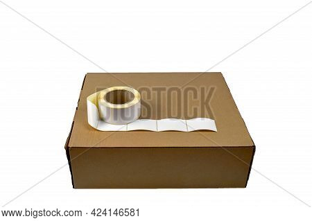 Stickers And Cardboard Box, Isolate On A White Background. Sticky White Labels. Self-adhesive Sticke