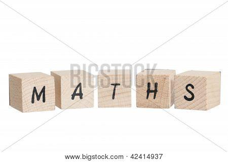 Maths Written With Wooden Blocks.