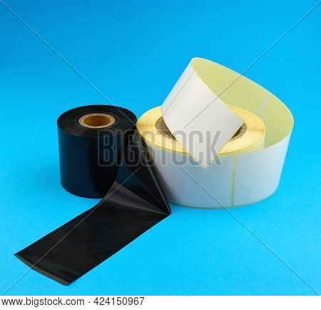 Roll Of Self-adhesive Stickers And Tape For Thermal Transfer Printing. Ribbon Ttr.