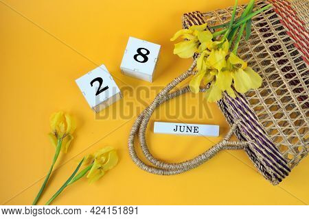 Calendar For June 28: Cubes With The Number 28, The Name Of The Month Of June In English, Yellow Iri