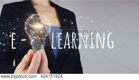 E-learning Concept. E-learning Education Internet Online Courses Concept. Hand Hold Digital Light Bu