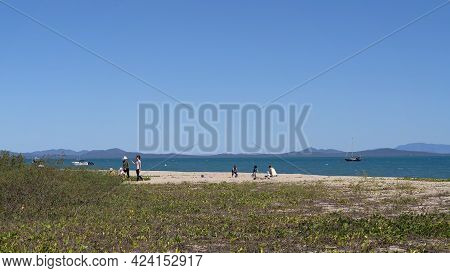 Cape Gloucester, Queensland, Australia - June 2021: Families Playing On The Sand At Beachfront Tropi