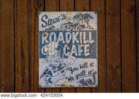 Cape Gloucester, Queensland, Australia - June 2021: Humorous Sign On A Wall For Roadkill Cafe Joke