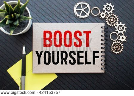 Boost Your Self Confidence Word On Cardboard Background.