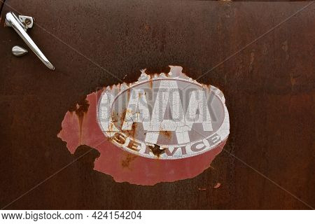 Arthur, North Dakota ,april 28, 2021: The Remnants Of A Sticker On A Rusty Truck Door Advertises The