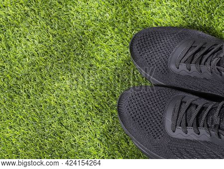 Sports Shoes On Synthetic Grass - Text Space