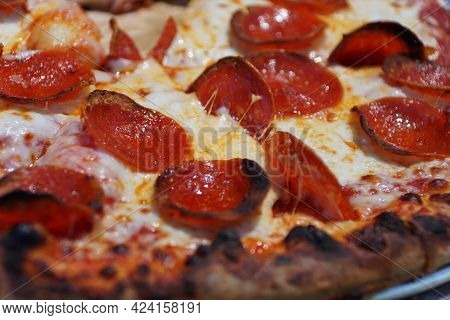 Close Up Of A Pepperoni And Cheese Pizza