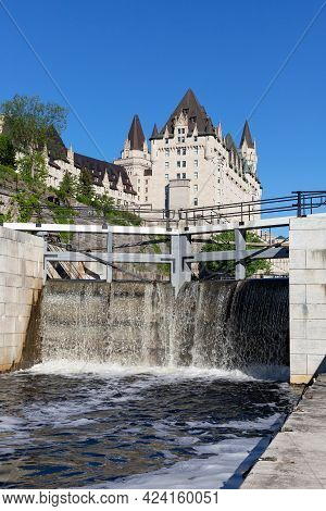 Ottawa, Canada - May 23, 2021: Rideau Canal Locks And Luxury Fairmont Chateau Laurier Hotel In Ottaw