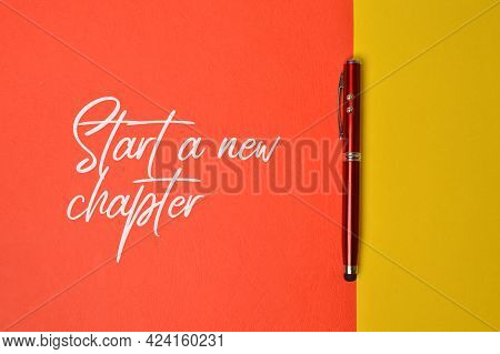 Top View Of Pen With Text Start A New Chapter.