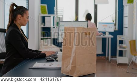 Businesswoman Holding Paper Bag With Takeaway Food Meal Order Putting On Desk During Takeout Lunchti