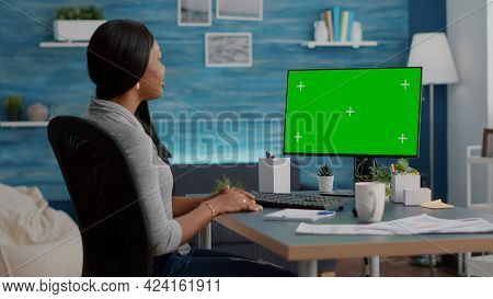 African American Student Sitting At Desk Working Remote From Home During Virtual Videocall Meeting C