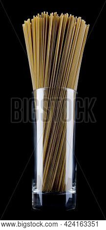 Long Spaghetti With Spinach Isolated On Black Background. Spinach Pasta In A Glass Beaker. Colored S