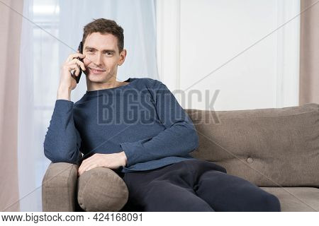 Portrait Of Happy Positive Guy In Good Mood, Young Handsome Man Is Talking On His Cell Mobile Phone,