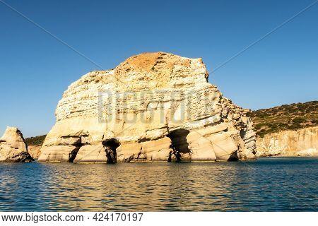 Peculiar Kleftiko Limestone Sea Rocks Formations On The Southwest Coast Of Milos Island, With A Laby