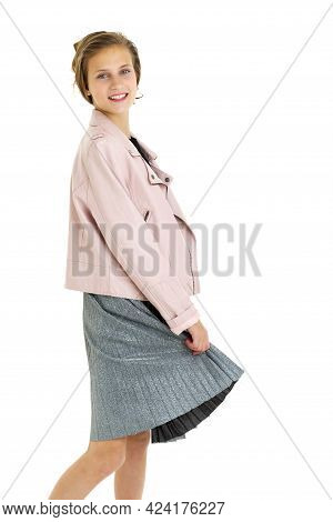 Happy Smiling Whirling Teenage Girl. Joyful Attractive Brown Haired Girl Dressed Pink Leather Jacket