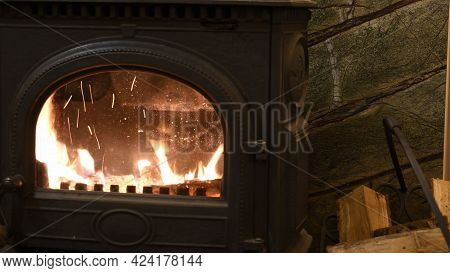 Soft Focus Burning Fire In Cast-iron Potbelly Stove Of Retro Style Interior. Blurred Flame In Antiqu