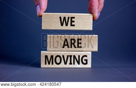 We Are Moving Symbol. Wooden Blocks With Words 'we Are Moving'. Beautiful Grey Background, Businessm