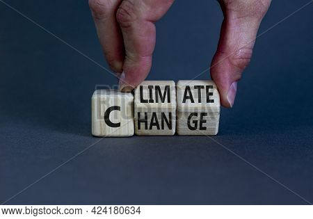 Climate Change Symbol. Businessman Turns Cubes With Words 'climate Change'. Beautiful Grey Backgroun