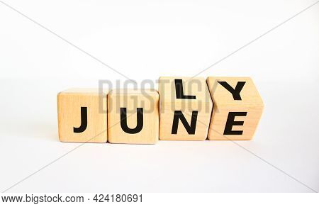 From June To July Symbol. Turned Wooden Cubes And Changed The Word 'june' To 'july'. Beautiful White