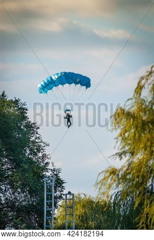 Paratrooper Flying Over The City Park In Belgrade Serbia, During The Boat Carnival