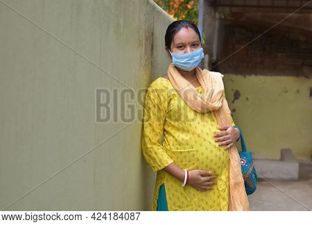 Indian Rural Pregnant Women Wearing Medical Masks Due To Illness, Dizziness. Healthy Pregnancy Conce