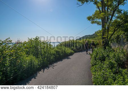 Two Women Take An Ealy Morning Walk Along The Henry Hudson Trail In Atlantic Highlands New Jersey.