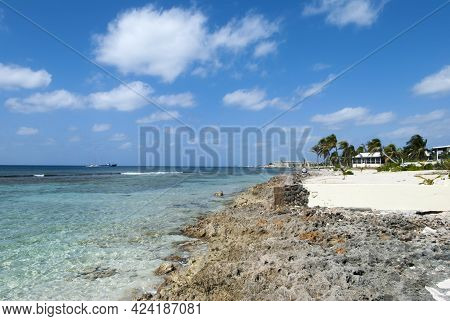 The View Of Grand Cayman Rocky Coastline And Transparent Waters (cayman Islands).