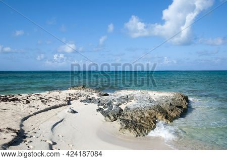 The View Of Rocky And Sandy Beach On Grand Turk Island (turks And Caicos Islands).