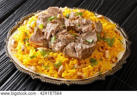 Mansaf A Feast Dish Of Lamb In Yogurt Sauce Atop Flatbread And A Bed Of Rice, Is Known As The Nation