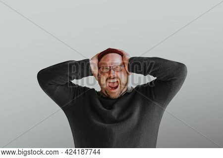 Stressed man screaming out loud