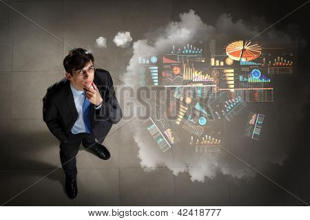 Top view of young businessman making decision diagram in air