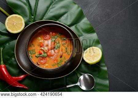 Tom Yam Kung Spicy Thai Soup With Shrimps, Coconut Milk And Chili Pepper In Bowl.