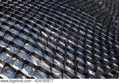 Polymer Geogrid For Filled With Soil. Protection Of Sandy Slopes With A Geogrid