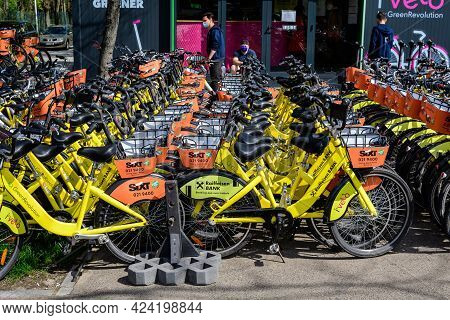 Bucharest, Romania, 24 April 2021: Public Bike Sharing Bicycles From Ivelo, Sixt And Raiffeisen Bank